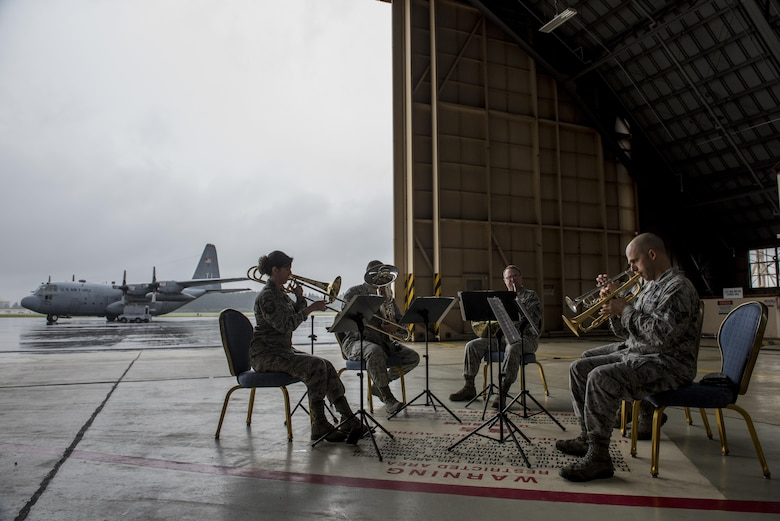Members of the U.S. Air Force band of Pacific-Asia perform prior to the C-130H farewell ceremony at Yokota Air Base, Japan, Oct. 16, 2017.