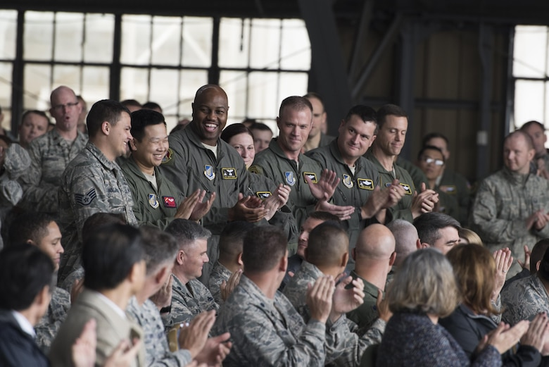 Members from the 374th Aircraft Maintenance Squadron applauds an air crew during the official C-130H Hercules Farewell Ceremony at Yokota Air Base, Japan, Oct. 16, 2017.