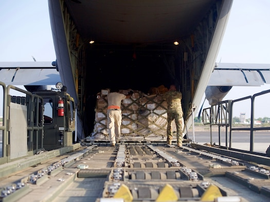 U.S. Airmen from the 449th Air Expeditionary Group load pallets of medical and humanitarian aid supplies onto a U.S. C-130J Super Hercules at Camp Lemonnier, Djibouti, Oct. 17, 2017.