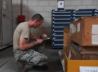 U.S. Air Force Staff Sgt. Zachery Deuyour, aircraft parts store NCO in-charge assigned to 447th Air Expeditionary Group, takes inventory of select weapon system spares and supply assets at Incirlik Air Base, Turkey, Sept. 21, 2017. APS Airmen are in charge of issuing, receiving, recording, stocking and supplying various aircraft parts and live-saving equipment within the warehouse. (U.S. Air Force photo by Senior Airman Jasmonet D. Jackson)