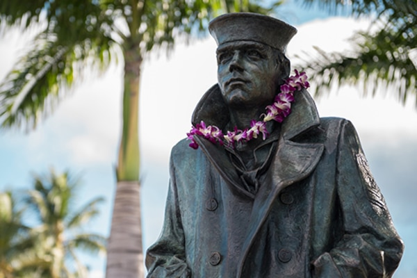 The new Lone Sailor statue stands at the Pearl Harbor Visitor Center in Hawaii, overlooking the USS Arizona Memorial. Navy photo by Petty Officer 2nd Class Somers T. Steelman