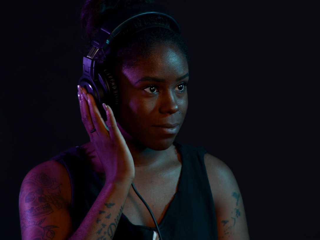U.S. Air Force Senior Airman Asia Moore, 100th Force Support Squadron fitness specialist, demonstrates her DJ equipment, Sept. 22, 2017, on RAF Mildenhall, England. Moore started DJing in 2015 and has since performed at base events, private parties and at clubs in the local area. (U.S. Air Force photo by Senior Airman Justine Rho)