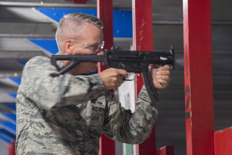 Maj. Gen. Jacobson shoots a weapon