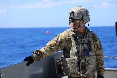 Army Sgt. James Munar, a Pomona, Calif., native and a culinary specialist with the 605th Transportation Detachment, 8th Special Troops Battalion, 8th Theater Sustainment Command, helps prepare for the waterborne gunnery mission on the logistic support vessel, the USAV CW3 Harold A. Clinger, off the Hawaiian coast, Oct. 4, 2017. Army photo by Staff Sgt. Melissa Parrish