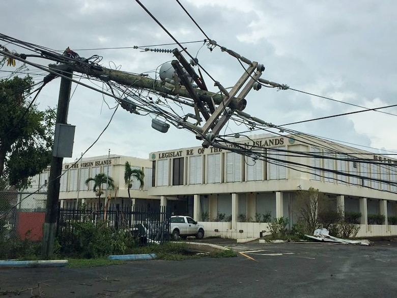 A telephone pole is snapped in two outside the Legislature of the Virgin Islands office building in Frederiksted on St. Croix, USVI.