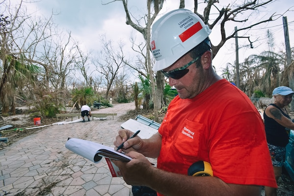 Albert Masticola, a USACE blue roof quality assessor from the Louisville District, takes notes as he surveys damage done by Hurricane Irma to a home in Summerland Key, Florida.