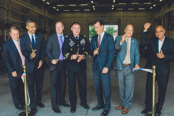 Major Gen. Troy D. Kok, commanding general of the 99th RSC, center, cut the ribbon at the revitalized facility in Fort Totten.