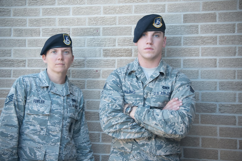 Staff Sgt. Emily Fowler and Senior Airman Jonathan Kling, 403rd Security Forces Squadron fire team members, pose for a photo after completing U.S. Army Air Assault School Sept. 26, 2017 at Keesler Air Force Base, Mississippi. (U.S. Air Force photo/Staff Sgt. Heather Heiney)