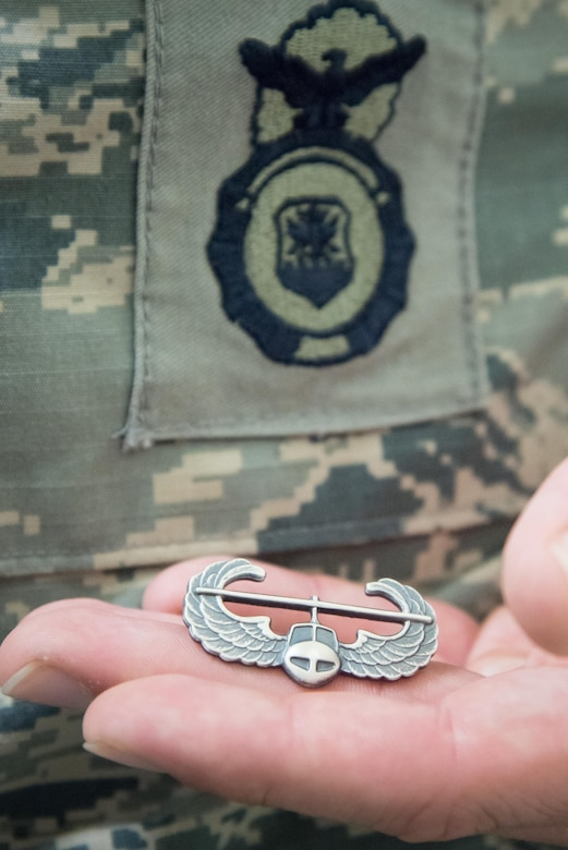 Senior Airman Jonathan Kling, 403rd Security Forces Squadron fire team member, shows off his new Air Assault badge along with his Security Forces badge after completing U.S. Army Air Assault School Sept. 26, 2017 at Keesler Air Force Base, Mississippi. (U.S. Air Force photo/Staff Sgt. Heather Heiney)