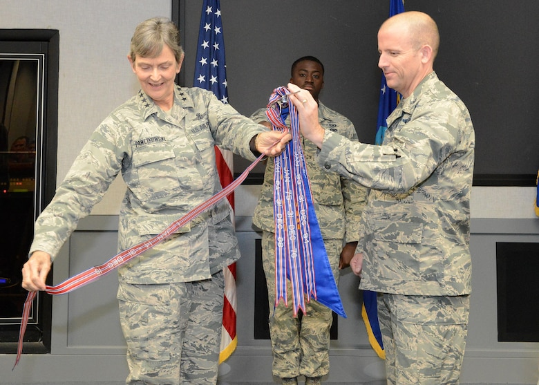 Gen. Ellen Pawlikowski, commander of Air Force Materiel Command, placed a new award streamer on the U.S. Air Force Test Pilot School guidon Oct. 12 with the assistance of Col. Matthew Higer, U.S.A.F. TPS commandant. The streamer is for TPS winning the Air Force Organizational Excellence Award recently. (U.S. Air Force photo by Kenji Thuloweit)
