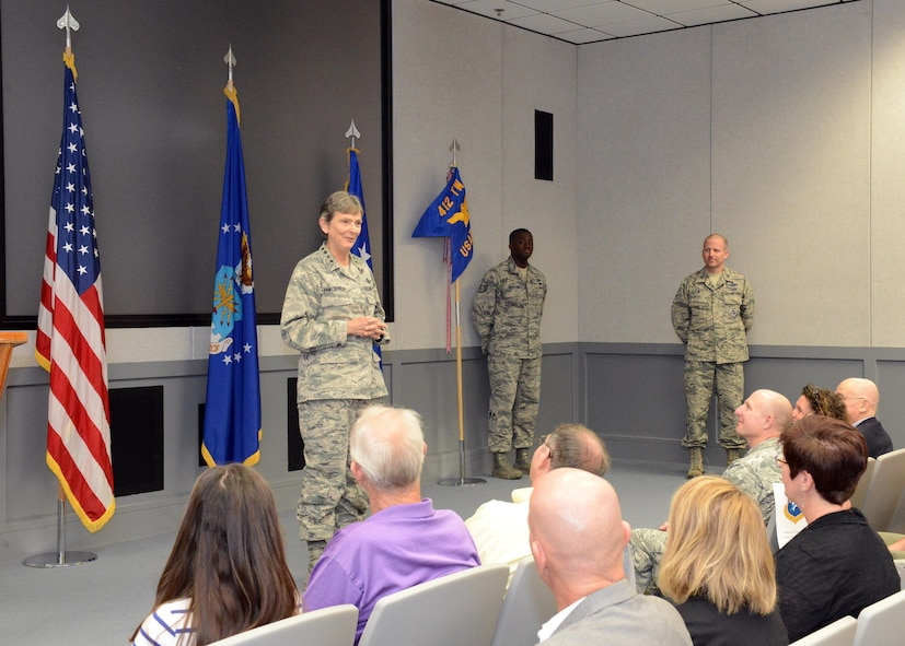 Gen. Ellen Pawlikowski, commander of Air Force Materiel Command, speaks to an audience at the U.S. Air Force Test Pilot School's Dick Scobee Auditorium Oct. 12. Pawlikowski presided over a ceremony where TPS was recognized for winning the Air Force Organizational Excellence Award. (U.S. Air Force photo by Kenji Thuloweit)