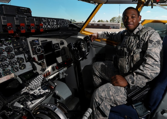 Senior Airman Demetrio V. Vega, stationed at the 171st Air Refueling Wing located near Pittsburgh Pennsylvania poses in cockpit of a KC-135 Tanker