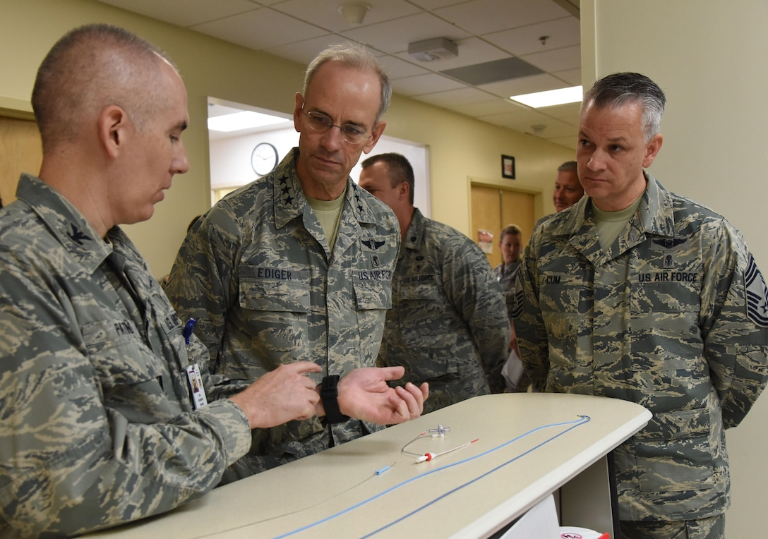 Col. Gilberto Patino, 81st Medical Operations Squadron cardiopulmonary flight commander, explains surgical procedures used in the cardiac catheterization lab to Lt. Gen. Mark Ediger, Air Force Surgeon General, and Chief Master Sgt. Steve Cum, Jr., Air Force Surgeon General medical enlisted force chief, during a visit to the 81st Medical Group Oct. 17, 2017, on Keesler Air Force Base, Mississippi. The purpose of Ediger's visit was to get familiar with the 81st MDG's mission, operations and personnel. During his tour, he visited more than 10 different units in the 81st MDG to include mammography, emergency department, radiology and oncology, genetics and the clinical research laboratory. (U.S. Air Force photo by Kemberly Groue)