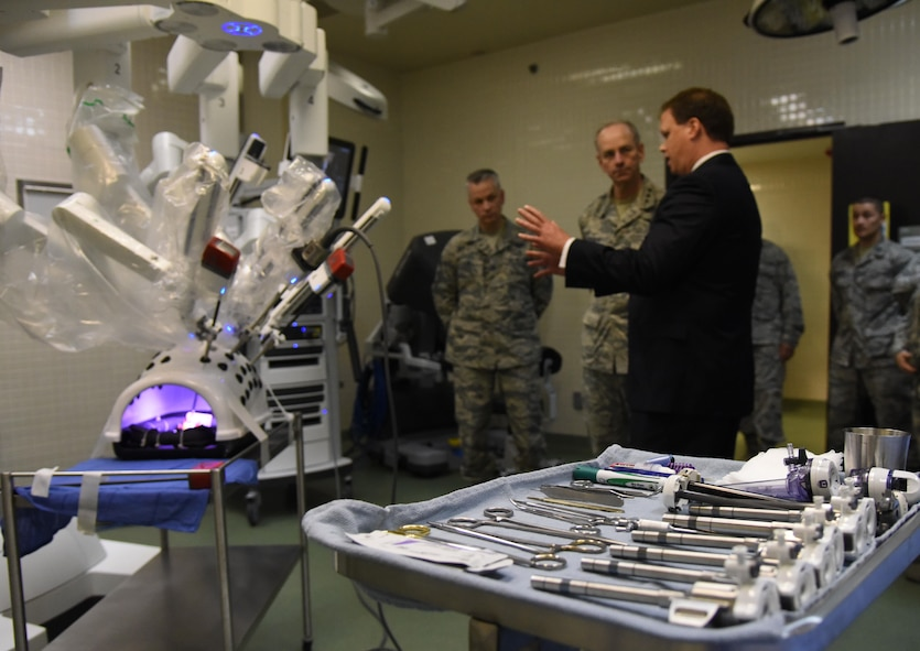 Blaise Provitola, Intuitive Surgical Inc. area sales manager, briefs on the capabilities of robotics surgery to Lt. Gen. Mark Ediger, Air Force Surgeon General, and Chief Master Sgt. Steve Cum, Jr., Air Force Surgeon General medical enlisted force chief, during a visit to the clinical research laboratory  Oct. 17, 2017, on Keesler Air Force Base, Mississippi. The purpose of Ediger's visit was to get familiar with the 81st Medical Group's mission, operations and personnel. During his tour, he visited more than 10 different units in the 81st MDG to include mammography, emergency department, radiology and oncology, genetics and the clinical research laboratory. (U.S. Air Force photo by Kemberly Groue)