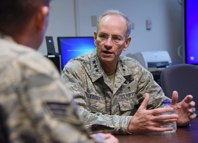 Lt. Gen. Mark Ediger, Air Force Surgeon General, delivers comments for an interview conducted by Senior Airman Travis Beihl, 81st Training Wing public affairs specialist, during a visit to the Clinical Research Lab Oct. 17, 2017, on Keesler Air Force Base, Mississippi. The purpose of Ediger's visit was to get familiar with the 81st Medical Group's mission, operations and personnel. During his tour, he visited more than 10 different units in the 81st MDG to include mammography, emergency department, radiology and oncology, genetics and the clinical research laboratory. (U.S. Air Force photo by Kemberly Groue)