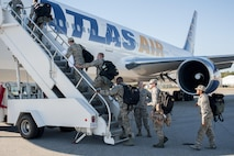 187th Fighter Wing Airmen board the plane for a deployment to Southwest Asia.