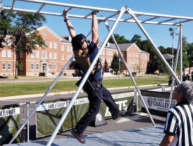 A Quantico Fire and Emergency Services member takes to the monkey bars.