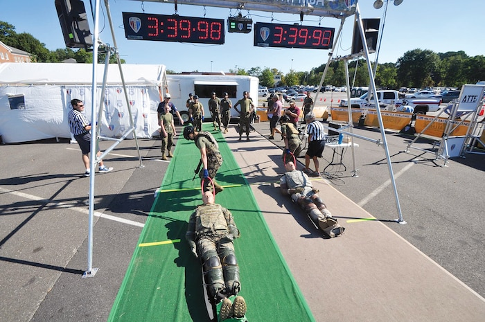 Two female Marines finishing the final stretch of the Battle Challenge.