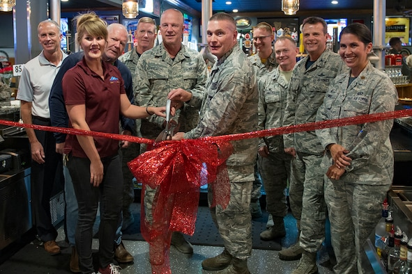 "PETERSON AIR FORCE BASE, Colo. – Gen. John ""Jay"" Raymond, Air Force Space Command commander, and Col. Eric Dorminey, 21st Space Wing vice commander, conduct a ribbon cutting ceremony at the Colorado Pizza and Sports Grill on Peterson Air Force Base, Colorado, Oct. 13, 2017. The venue reopened August 25 after extensive renovations. (U.S. Air Force photo by Dave Grimm)"