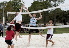 Airmen play volleyball