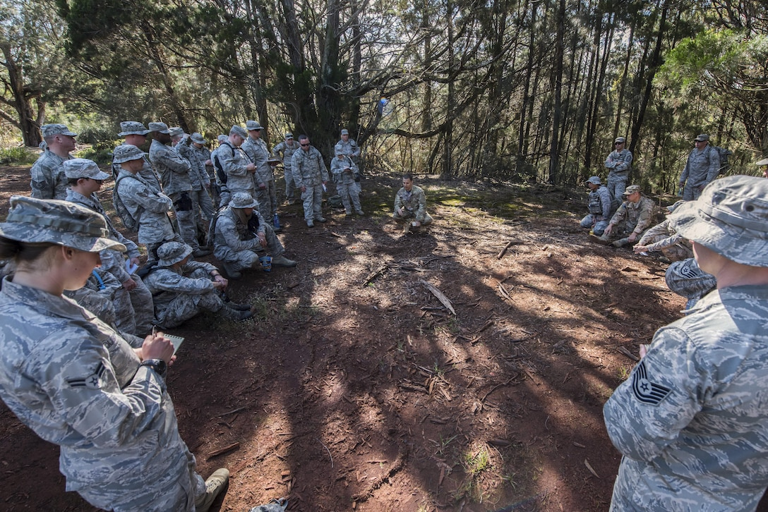 Security Forces Airmen from the 141st and 194th Security Forces Squadrons from Washington State watch as a jungle warfare training instructor demonstrates basic tracking techniques March 8, 2017, at a training site on Schofield Barracks, Hawaii. Airmen were taught to look for disturbed ground, broken branches and grass, or any other physical evidence that would suggest recent human activity. (U.S. Air National Guard photo by Staff Sgt. Rose Lust/Released)