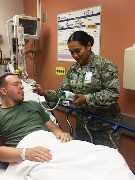 U.S. Air Force Senior Airman Wendy Crow, a medical technician in the New York Air National Guard's 106th Rescue Wing, takes the temperature of a patient at Joint Base Pearl Harbor-Hickam in Hawaii Aug. 29, 2017. 106th Rescue Wing Medical Group members went on a 13-day deployment for training opportunity, which wrapped up in September, came about for 106th Rescue Wing medical personnel after scoring in the top five of 90 medical units evaluated in the nation.