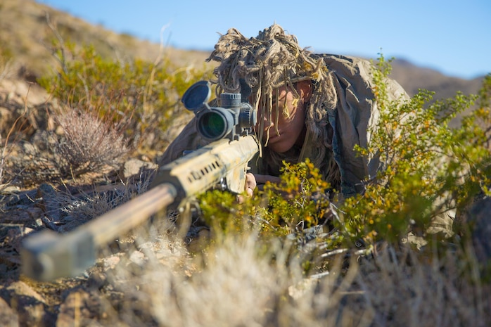 U.S. Marine Corps Lance Cpl. Joseph Starr, a professionally instructed gunman with Regimental Surveillance and Target Acquisition Company (RSTAC), 1st Marine Division, acquires targets during a field operation at Fort Irwin, Calif., October 2, 2017.