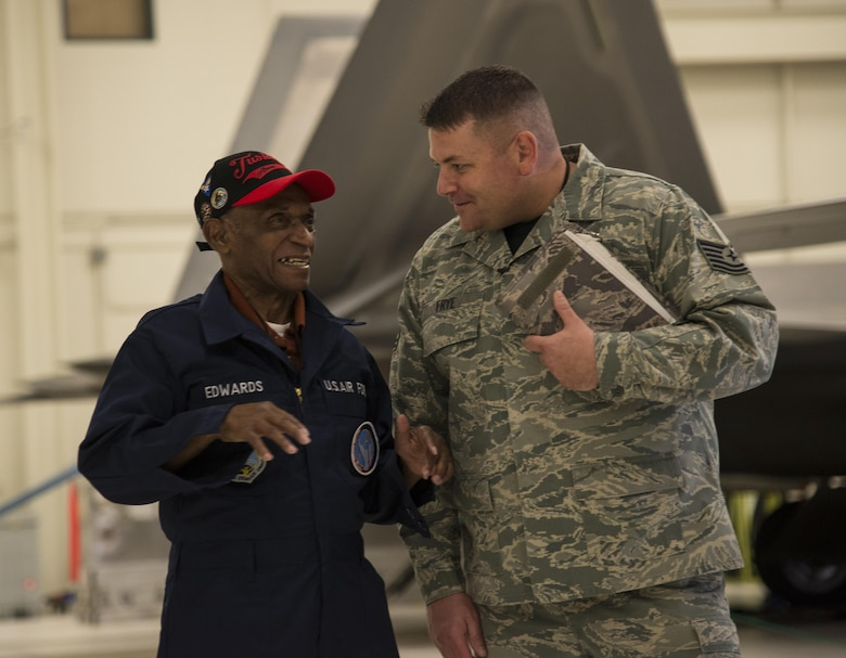 Army Air Corps Staff Sgt. Leslie Edwards, the last known living Tuskegee Airman of the the 477th Bombardment Group, meets U.S. Air Force Tech. Sgt. Jeremiah Frye, 477th Fighter Group quality assurance inspector, at Joint Base Elmendorf-Richardson, Alaska, Oct. 14, 2017. In 2007, the 477th Bombardment Group became the 477th Fighter Group, bringing with it the legacy of Tuskegee Airmen to Alaska. (U.S. Air Force photo by Senior Airman Curt Beach)