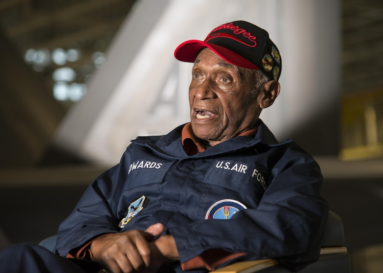Army Air Corps Staff Sgt. Leslie Edwards, the last living Tuskegee Airman  of the 477th Bombardment Group, speaks with historians at Joint Base Elmendorf-Richardson, Alaska, Oct. 14, 2017. In 2007, the 477th Bombardment Group became the 477th Fighter Group, bringing with it the legacy of Tuskegee Airmen to Alaska. (U.S. Air Force photo by Senior Airman Curt Beach)