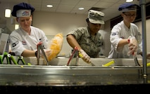 U.S. Air Force Airman 1st Class Kaeleigh Mueller, left, services journeymen, Airman 1st Class Chyna Johnson, center, a services apprentice, and Senior Airman Brandy Schaff, right, a services journeymen, all assigned to the 6th Force Support Squadron, restock the salad bar during lunch in the dining facility at MacDill Air Force Base, Fla., Oct. 19, 2017. The MacDill dining facility provides various food options to their customers including a salad bar, to-go items and hot food selections. (U.S. Air Force photo by Senior Airman Mariette Adams)