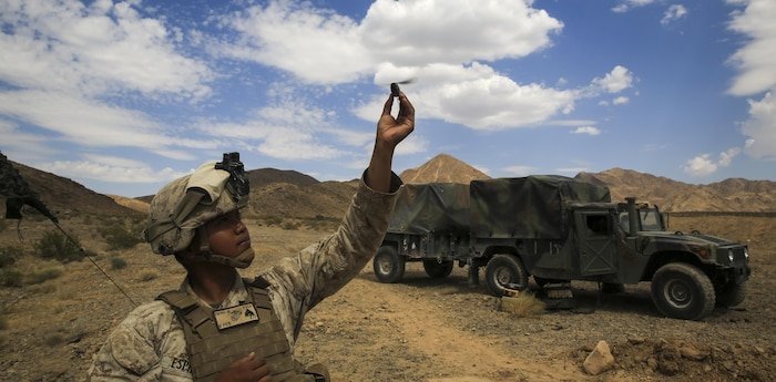 Cpl. Jerrick Espino, an intelligence analyst with 2nd Battalion, 7th Marine Regiment, 1st Marine Division, lands a PD-100 Black Hornet micro unmanned aerial vehicle during a Marine Corps Combat Readiness Evaluation at Marine Air Ground Combat Center Twentynine Palms, Calif., July 8, 2017.