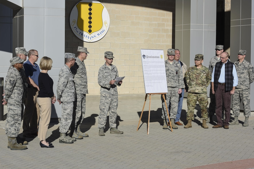 U.S. Air Force Airman Alexander Presley, 17th Civil Engineer Squadron emergency management apprentice, reads the Energy Week proclamation before Col. Jeffrey Sorrell, 17th Training Wing vice commander, signs it in front of the Norma Brown building on Goodfellow Air Force Base, Texas, Oct. 17, 2017. The week of Oct. 17 through 24 was recognized as Energy Week, bringing awareness to the need of energy conservation. (U.S. Air Force photo by Airman 1st Class Zachary Chapman/Released)