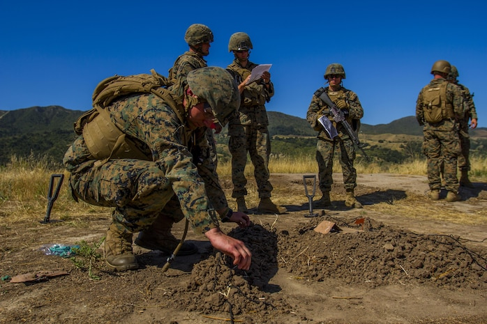Marines with 4th Combat Engineer Battalion, 4th Marine Division, create a terrain model during the SAPPER Squad Competition held at Camp Pendleton, Calif., from June 12 to 16, 2017.