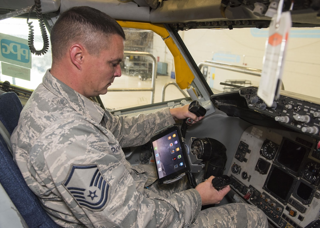 Master Sgt. Gavin Douglas, 92nd Maintenance Group Air Force Repair Enhancement Program manager, tests an iPad mount on the steering column of a KC-135 Stratotanker Oct. 16, 2017, at Fairchild Air Force Base, Washington. The AFREP team has developed specialized iPad mounts