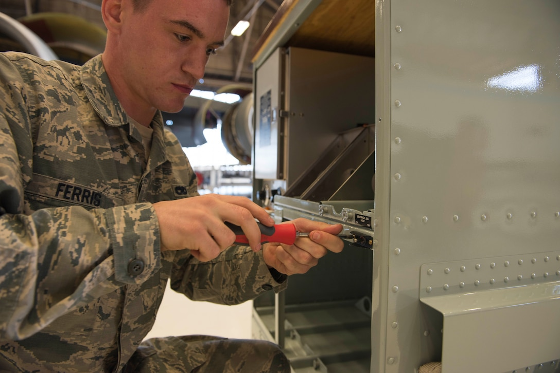 Staff Sgt. Tyler Ferris, 92nd Maintenance Group Air Force Repair Enhancement Program technician, tightens a screw to a KC-135 Stratotanker galley Oct. 16, 2017, at Fairchild Air Force Base, Washington. The AFREP program saves money through cost savings and cost avoidance. Through cost savings, an asset is repaired instead of thrown away and put back into the Air Force inventory. Through cost avoidance, the AFREP team finds equipment that is around their facility in need of repair and rather than throw it away and buy new equipment, they repair it and put it back into service. (U.S. Air Force photo/Senior Airman Ryan Lackey)