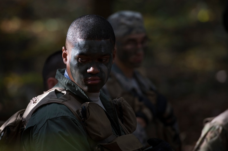 Staff Sgt. Yannick Sharras, 86th Aeromedical Evacuation Squadron aeromedical evacuation technician, looks back at his captors  during a survival, evasion, resistance, escape field training exercise at U.S. Army Garrison Rheinland-Pfalz, Oct. 18, 2017. The exercise included the members camouflaging themselves to avoid being detected by any hostile forces in the area. (U.S. Air Force photo by Airman 1st Class Devin M. Rumbaugh)