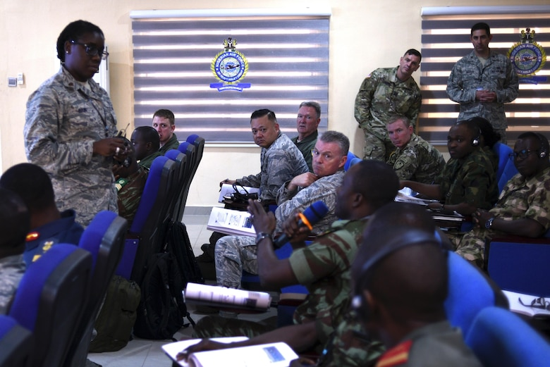 A participant asks Maj. Allison Bain, U.S. Air Forces Europe - Air Forces Africa Surgeon General medical plans and operations chief, about medical planning during her brief, Lagos, Nigeria, Aug. 15, 2017.