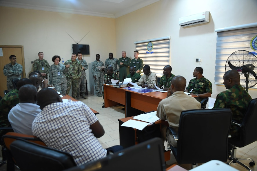 U.S. Air Force Lt. Col. Kimberly Polston, U.S. Air Forces Europe-Air Force Africa Surgeon General internation health specialist team lead, addresses the simulated Multinational Joint Task Force during African Partnership Flight Nigeria, Aug. 16, 2017.