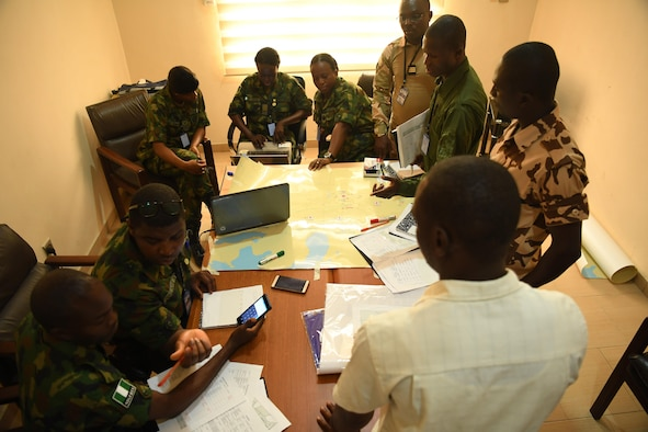 Airmen from Nigeria, Niger, Chad, and Benin discuss options for aeromedical support during African Partnership Flight Nigeria, Lagos, Nigeria, Aug. 17, 2017.
