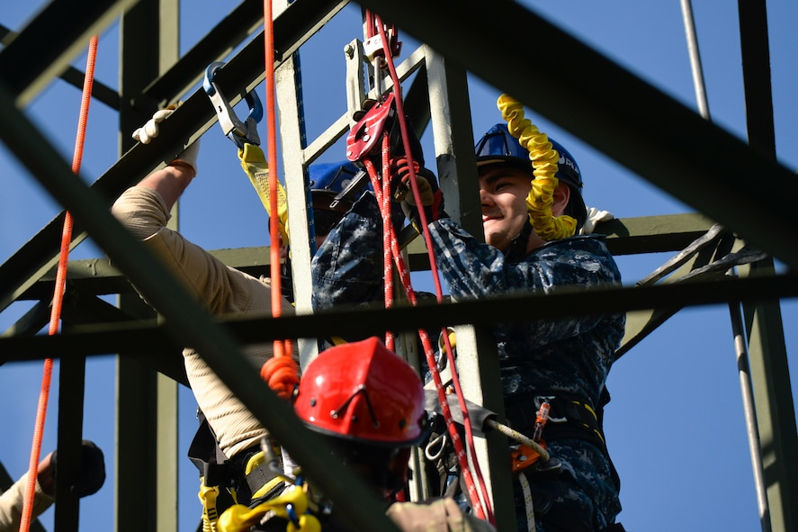 Soldiers, Seamen and Airmen simulate a rescue mission during a tower and rescue climbing training on Ramstein Air Base, Germany, Oct. 19, 2017. The course was hosted by the 1st Communication Maintenance Squadron Airmen. (U.S. Air Force photo by Staff Sgt. Nesha Humes Stanton)