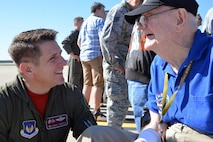 "U.S. Air Force Col. Christopher Amrhein, 100th Air Refueling Wing commander, speaks to Frank ""Bud"" Buschmeier during the opening event of the 100th Bomb Group Foundation reunion at Washington Dulles International Airport, Va., Oct. 19, 2017. Buschmeier is a World War II veteran who flew on 34 missions over Europe. (U.S. Air Force photo/Tech. Sgt. David Dobrydney)"