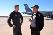 U.S. Air Force Airman 1st Class Derek Piefer, 351st Air Refueling Squadron boom operator, talks with Ron Batley during the opening event of the 100th Bomb Group Foundation reunion at Washington Dulles International Airport, Va., Oct. 19, 2017. The event featured a static display of a B-17 Flying Fortress and KC-135 Stratotanker. Batley is the curator of the 100th Bomb Group Memorial Museum in England. (U.S. Air Force photo/Tech. Sgt. David Dobrydney)