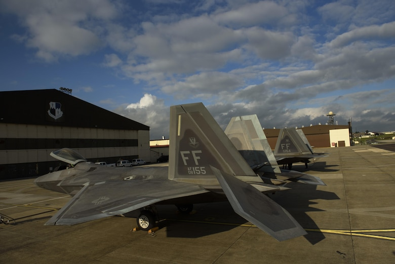 Two F-22 Raptors assigned to the 1st Fighter Wing, Joint Base Langley-Eustis, Va., sit on the flightline at Spangdahlem Air Base, Germany, Oct. 13, 2017.