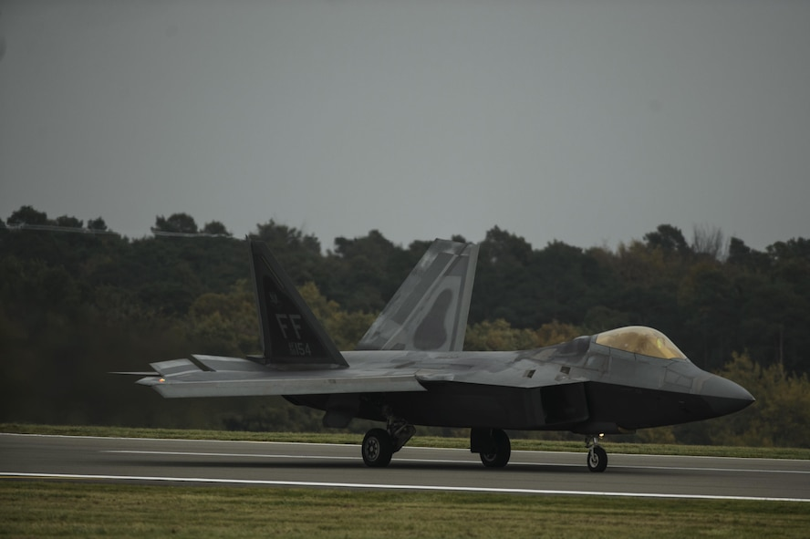 An F-22 Raptor assigned to the 1st Fighter Wing, Joint Base Langley-Eustis, Va., lands at Spangdahlem Air Base, Germany, Oct. 13, 2017.