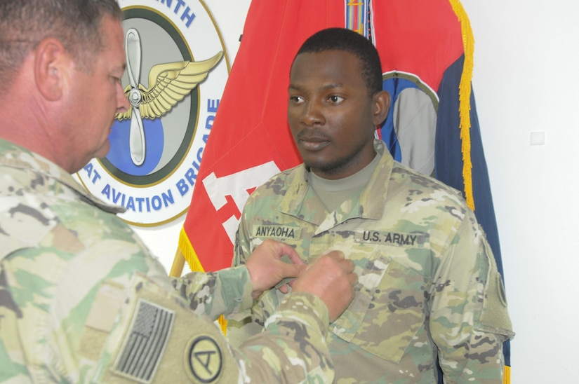 Solider receiving a patch during promotion.