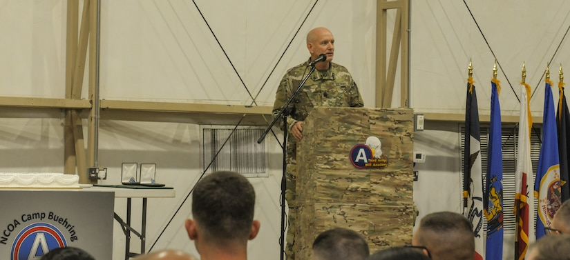 Soldier at a podium giving a speech.