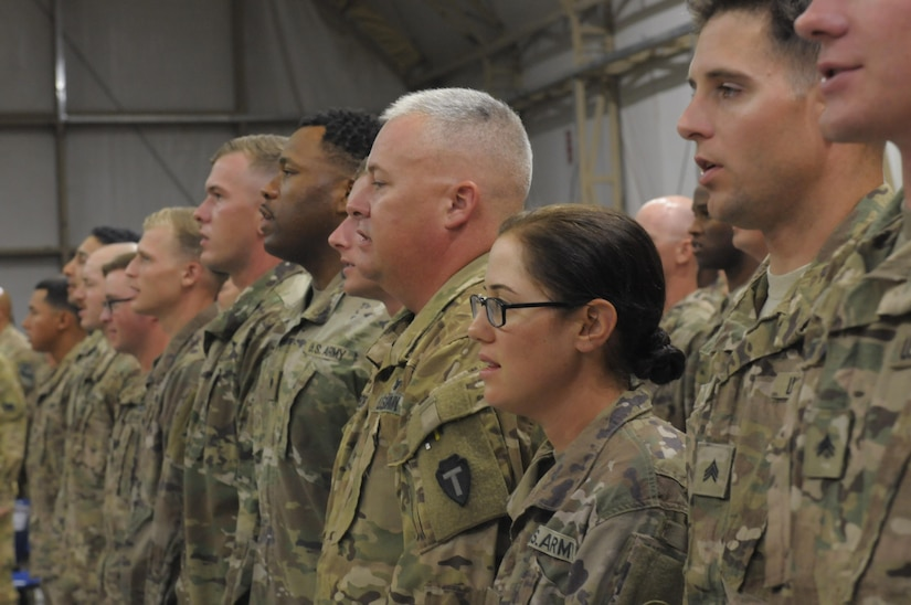 Soldiers standing in line.