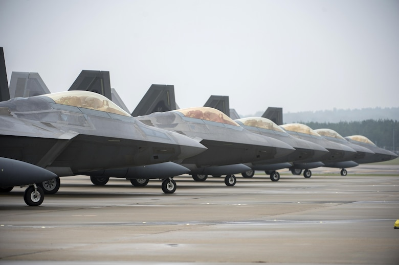 F-22 Raptors prepare to take off at the flightline on Royal Air Force Lakenheath, England, Oct. 19. Six F-22 Raptors transited through RAF Lakenheath. (U.S. Air Force photo/Staff. Sgt. Emerson Nuñez)
