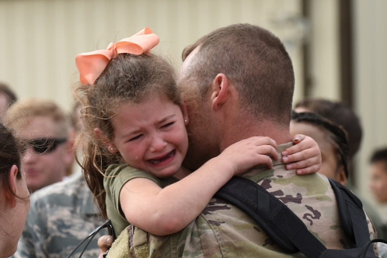 A 48th Fighter Wing Airman embraces a family member at RAF Lakenheath, England, after returning from a deployment Oct. 11, 2017. F-15E Strike Eagles and Airmen from the 492nd Fighter Squadron and supporting units across the 48th Fighter Wing returned from a six-month deployment to an undisclosed location in Southwest Asia.