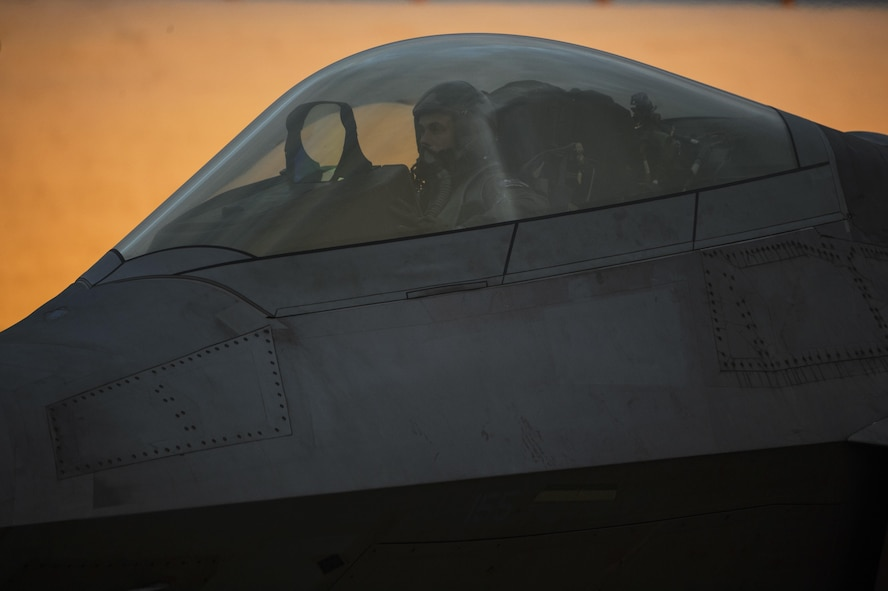 An F-22 Raptor pilot assigned to the 1st Fighter Wing, Joint Base Langley-Eustis, Va., conducts a preflight check at Spangdahlem Air Base, Germany, Oct. 13, 2017. This F-22 flying training deployment is an example of how the U.S. is engaged, postured, and ready with credible force to assure, deter, and defend in an increasingly complex security environment.